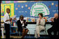 "Mrs. Laura Bush joins Our Lady of Perpetual Help School principal Charlene Hursey, left, and Cardinal Theodore McCarrick, Archbishop of Washington, D.C., in applauding student Marquette Lewis, 11, after his reading of the poem ""Coming of Age,"" Monday, June 5, 2006. Mrs. Bush visited the school to announce a Laura Bush Foundation for America's Libraries grant to Our Lady of Perpetual Help School. White House photo by Shealah Craighead"