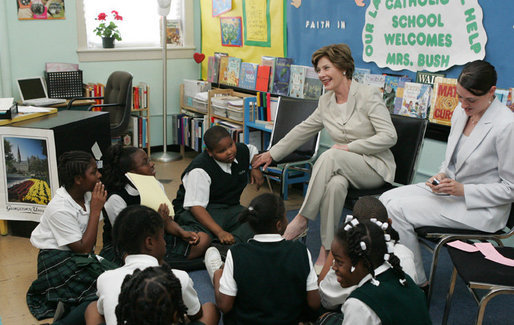 Mrs. Laura Bush talks with students during her visit to Our Lady of Perpetual Help School in Washington, Monday, June 5, 2006, where she announced a Laura Bush Foundation for America's Libraries grant to the school. Mrs. Bush is joined by Our Lady of Perpetual Help fifth grade teacher Julie Sweetland, right. White House photo by Shealah Craighead