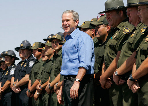 President George W. Bush joins U.S. Border Patrol agents on stage before delivering remarks on border security at the Federal Law Enforcement Training Center Artesia Facility in Artesia, New Mexico, Tuesday, June 6, 2006. White House photo by Eric Draper