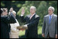 President George W. Bush stands with former Idaho Gov. Dirk Kempthorne as he is sworn-in as the new U.S. Secretary of Interior by Supreme Court Justice Antonin Scalia, left, Wednesday, June 7, 2006 on the South Lawn of the White House in Washington. Patricia Kempthorne holds the Bible during her husband's swearing-in, joined by their children Heather Myklegard and son, Jeff Kempthorne. White House photo by Eric Draper