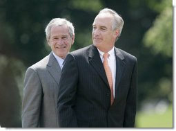 President George W. Bush invites former Idaho Gov. Dirk Kempthorne to the podium, after Kempthorne's swearing-in ceremony as the new U.S. Secretary of Interior, Wednesday, June 7, 2006 on the South Lawn of the White House in Washington. White House photo by Eric Draper
