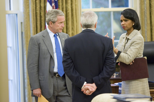 President George W. Bush talks with Secretary of State Condoleezza Rice and White House Chief of Staff Joshua Bolten in the Oval Office after receiving news of terrorist al Zarqawi's death in Iraq at 4:49 p.m. Wednesday, June 7, 2006. White House photo by Eric Draper