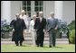 President George W. Bush walks with former Idaho Gov. Dirk Kempthorne prior to his swearing-in ceremony as the new U.S. Secretary of Interior by Supreme Court Justice Antonin Scalia, left, Wednesday, June 7, 2006 on the South Lawn of the White House in Washington. Patricia Kempthorne, center, who held the Bible during her husband's swearing-in, is joined by their children Heather Myklegard and son, Jeff Kempthorne. White House photo by Kimberlee Hewitt