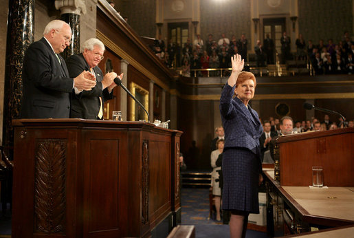 President Vaira Vike-Freiberga of Latvia acknowledges the applause of Vice President Dick Cheney, House Speaker Dennis Hastert and members of Congress, Wednesday, June 7, 2006, after an address to a Joint Meeting of Congress held in her honor at the U.S. Capitol in Washington. White House photo by David Bohrer