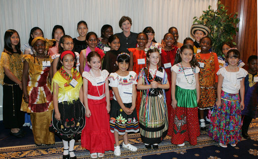 Mrs. Laura Bush poses with members of the St. Catherine Laboure School's Cultural Hertiage Choir, Thursday, June 8, 2006 at the President's Malaria Initiative conference at the National Press Club in Washington. The choir, dressed in heritage costumes, consists of students from first grade to eighth grade representing 20 nations. White House photo by Shealah Craighead