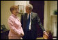 President George W. Bush talks with President Vaira Vike-Freiberga of Latvia in the Roosevelt Room Thursday, June 8, 2006. White House photo by Kimberlee Hewitt