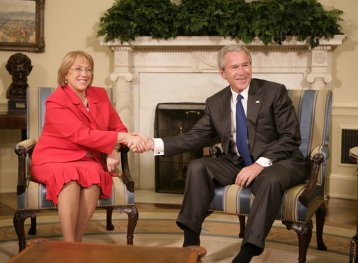 President George W. Bush welcomes President Michelle Bachelet of Chile to the Oval Office Thursday, June 8, 2006. White House photo by Kimberlee Hewitt