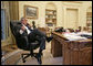 President George W. Bush talks with Prime Minister Nouri al-Maliki of Iraq regarding the death of terrorist al Zarqawi from the Oval Office Thursday morning, June 8, 2006. White House photo by Eric Draper