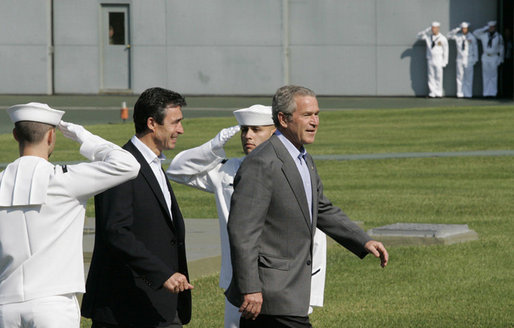 President George W. Bush escorts Prime Minister Anders Fogh Rasmussen of Denmark pass a U.S. Navy Honor Guard at Camp David Friday, June 9, 2006. Prime Minister Rasmussen and members of his family are visiting Camp David as guests of President Bush and Mrs. Laura Bush. White House photo by Eric Draper