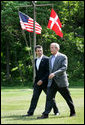 President George W. Bush walks with Prime Minister Anders Fogh Rasmussen of Denmark to their joint news conference at Camp David Friday, June 9, 2006. White House photo by Eric Draper