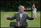 President George W. Bush gestures as he answers a reporter's question during his joint news conference with Prime Minister Anders Fogh Rasmussen of Denmark at Camp David Friday, June 9, 2006. White House photo by Eric Draper