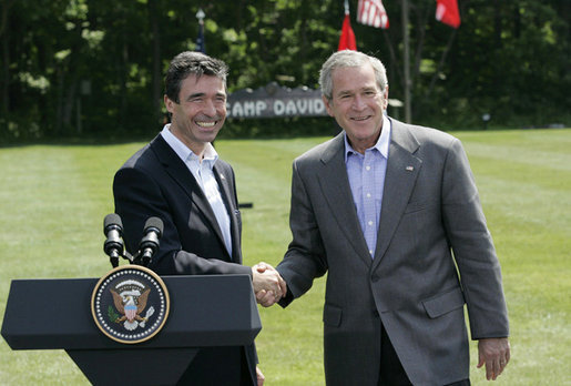 President George W. Bush and Prime Minister Anders Fogh Rasmussen of Denmark meet at Camp David Friday, June 9, 2006. White House photo by Eric Draper