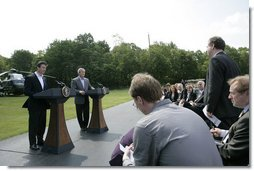 President George W. Bush and Prime Minister Anders Rasmussen of Denmark hold a joint news conference at Camp David Friday, June 9, 2006.  White House photo by Eric Draper