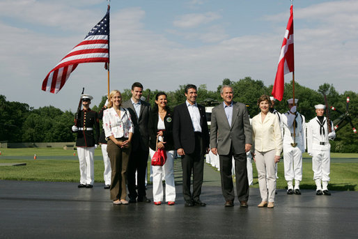 President George W. Bush and Mrs. Laura Bush welcome Prime Minister Anders Fogh Rasmussen of Denmark and his family to Camp David Friday, June 9, 2006. Pictured, from left, are the Prime Minister's daughter-in-law Kristina, son Henrik and wife Anne-Mette Rasmussen. White House photo by Shealah Craighead