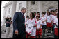 President George W. Bush talks with Imane Sallah from Morocco of the World Cup Soccer Youth Delegation on the North Portico steps of the White House Monday, June 12, 2006. The delegation is comprised of 30 soccer players representing 13 countries. White House photo by Paul Morse