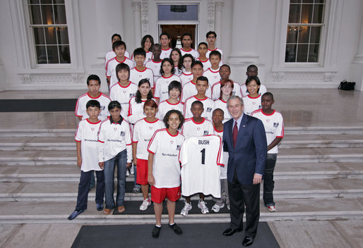 President George W. Bush stands with members of the World Cup Soccer Youth Delegation on the North Portico steps of the White House Monday, June 12, 2006. The delegation is comprised of 30 soccer players representing 13 countries. White House photo by Paul Morse
