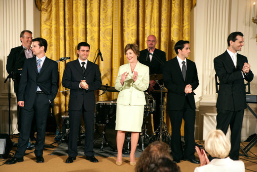Mrs. Laura Bush stands with members of the cast from the Tony award-winning musical Jersey Boys perform during a luncheon for Senate Spouses in the East Room Monday, June 12, 2006. White House photo by Shealah Craighead