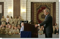 "President George W. Bush speaks to U.S. troops and U.S. embassy personnel during an unannounced 5-hour trip to Baghdad, Iraq, Tuesday, June 13, 2006. ""These are historic times,"" said the President. ""The mission that you're accomplishing here in Iraq will go down in the history books as an incredibly important moment in the history of freedom and peace; an incredibly important moment of doing our duty to secure our homeland.""  White House photo by Eric Draper"