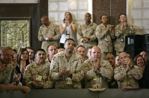 "U.S. troops listen to President George W. Bush speak during his an 5-hour trip to Baghdad, Iraq, Tuesday, June 13, 2006. ""I have come today to personally show our nation's commitment to a free Iraq. My message to the Iraqi people is this: seize the moment; seize this opportunity to develop a government of and by and for the people. And I also have a message to the Iraqi people that when America gives a commitment, America will keep its commitment."" White House photo by Eric Draper"