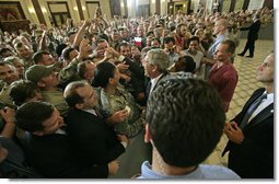 "President greets U.S. troops and U.S. embassy personnel during his trip to Baghdad, Iraq, Tuesday, June 13, 2006. ""This is a moment -- this is a time where the world can turn one way or the other, where the world can be a better place or a more dangerous place,"" said the President. ""And the United States of America and citizens such as yourself are dedicated to making sure that the world we leave behind is a better place for all."" White House photo by Eric Draper"