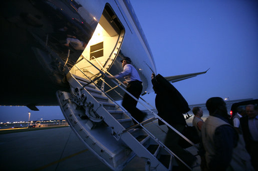 President George W. Bush boards Air Force One at Andrews Air Force Base Monday night, June 12, 2006, en route to Iraq. White House photo by Eric Draper