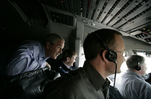 President George W. Bush rides in the cockpit of Air Force One on the final approach before landing in Baghdad Tuesday, June 13, 2006. White House photo by Eric Draper
