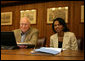 Vice President Dick Cheney and Secretary of State Condoleezza Rice smile while participating in a video teleconference from Camp David, Md. with President Bush and Iraqi Prime Minister Nouri al-Maliki in Baghdad, Tuesday, June 13, 2006. White House photo by David Bohrer