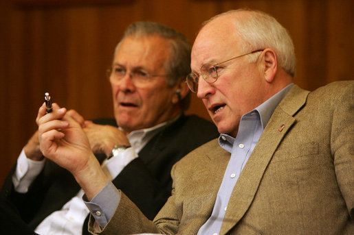 Vice President Dick Cheney talks with Secretary of Defense Donald Rumsfeld during a video teleconference from Camp David, Md. with President Bush and Iraqi Prime Minister Nouri al-Maliki in Baghdad, Tuesday, June 13, 2006. White House photo by David Bohrer