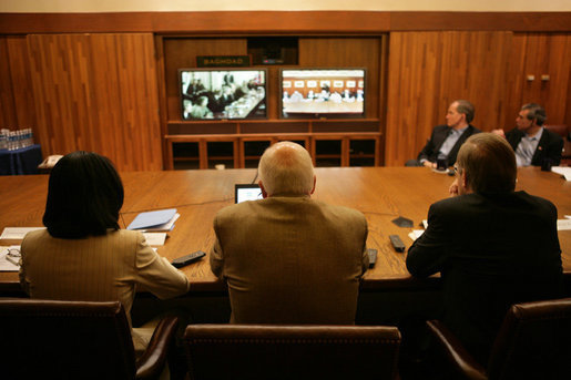 "Vice President Dick Cheney, Secretary of Defense Donald Rumsfeld, right, and Secretary of State Condoleezza Rice, left, participate in a video teleconference from Camp David, Md., Tuesday, June 13, 2006 as President Bush meets Iraqi Prime Minister Nouri al-Maliki in Baghdad. The President expressed praise for Prime Minister Maliki's efforts in assembling a strong and diverse unity government in Iraq and said, ""I want to thank you for giving me and my cabinet a chance to hear from you personally and a chance to meet the members of this team you've assembled. It's an impressive group of men and women, and if given the right help, I'm convinced you will succeed, and so will the world."" White House photo by David Bohrer"