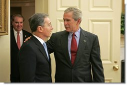 President George W. Bush welcomes Colombian President Alvaro Uribe to the Oval Office Wednesday, June 14, 2006. White House photo by Paul Morse