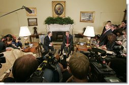 "President George W. Bush and Colombian President Alvaro Uribe meet with the press in the Oval Office Wednesday, June 14, 2006. ""We talked about trade. We negotiated a free trade agreement,"" said President Bush. ""We've still got some details to work out, but we committed ourselves to working out those details and try to get this done as quickly as we can."" White House photo by Paul Morse"