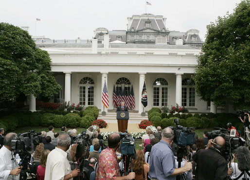 President George W. Bush talks with members of the media Wednesday morning, June 14, 2006, during a news conference in the Rose Garden, following his trip to Iraq where he met with members of the Iraq government and U.S. troops. White House photo by Kimberlee Hewitt