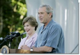 "President George W. Bush and Laura Bush welcome guests to the annual Congressional Picnic on the South Lawn of the White House Wednesday evening, June 15, 2006, hosting members of Congress and their families to the ""Rodeo"" theme picnic.  White House photo by Paul Morse"