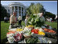 Guests look over a vegetable buffet table at the annual Congressional Picnic on the South Lawn of the White House Wednesday evening, June 15, 2006, an annual event started by former President Ronald Reagan to host members of Congress and their families. White House photo by Shealah Craighead