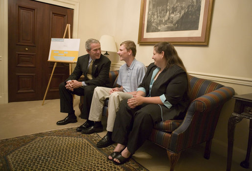 President George W. Bush meets with miner Randal McCloy Jr., and his wife Anna in the Eisenhower Executive Office Building Thursday, June 15, 2006, before signing S. 2803, the Mine Improvement and New Emergency Response Act. Mr. McCloy survived a January 2006 mining accident that left 12 others dead in Sago, West Virginia. White House photo by Eric Draper