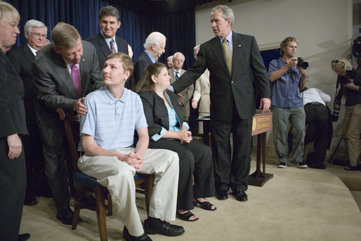 "President George W. Bush greets Anna McCloy, wife of miner Randal McCloy, during the signing of S. 2803, The MINER Act, in the Dwight D. Eisenhower Executive Office Building Thursday, June 15, 2006. Sen. Johnny Isakson, R-Ga., greets Randal McCloy. ""This year alone, accidents have taken the lives of 33 miners in our country,"" said President Bush. ""Just last month, five miners were killed in a mine explosion in Harlan County, Kentucky. And in January, Americans watched and prayed -- a lot of Americans prayed -- with the people of West Virginia for the 13 miners that were trapped underground by the explosion in the Sago mine. Only one man came out, and he's with us today -- Randal McCloy, and his wife, Anna. And we welcome you all."" White House photo by Eric Draper"