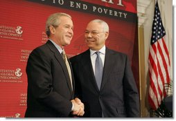 "President George W. Bush is introduced by former Secretary of State Colin Powell at the Initiative for Global Development's 2006 National Summit in Washington, D.C., Thursday, June 15, 2006. ""We have a moral duty to care for those who hurt here at home, and we have a moral duty to care for those as best as we can for those abroad, said the President. ""That's part of the foreign policy of our country."" White House photo by Kimberlee Hewitt"