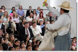 Mrs. Laura Bush watches Ricardo Araiza, one of the two actors, perform in the Childsplay production of Tomás and the Library Lady, at the Boys and Girls Club of the East Valley in Guadalupe, Arizona. The play promotes literacy and encourages young people to look past the confines of poverty, language barriers and cultural intolerance to find joy in reading.  White House photo by Shealah Craighead