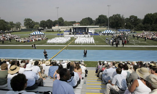 "Families and friends attend the graduation ceremony at the United States Merchant Marine Academy at Kings Point, New York, Monday, June 19, 2006. ""For more than six decades, the mission of this Academy has been to graduate highly skilled mariners to serve America's economic and national security needs,"" said President Bush. ""To train you for these responsibilities, this Academy sharpens your mind, it strengthens your body, and builds up your character."" White House photo by Kimberlee Hewitt"