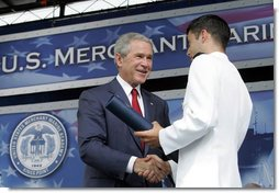 President George W. Bush greets graduates as they receive their degrees during the graduation ceremony at the United States Merchant Marine Academy at Kings Point, New York, Monday, June 19, 2006. White House photo by Kimberlee Hewitt