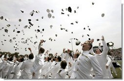 Graduates celebrate during their graduation ceremony at the United States Merchant Marine Academy at Kings Point, New York, Monday, June 19, 2006. White House photo by Kimberlee Hewitt