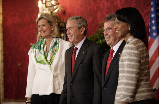 President George W. Bush is joined by Ursula Plassnik, Austria's Federal Minister of Foreign Affairs, and Secretary of State Condoleezza Rice Wednesday, June 21, 2006, as they stand with President Heinz Fischer of Austria for a photo opportunity prior to their meeting at Hofburg Palace in Vienna. White House photo by Eric Draper