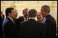 President George W. Bush looks at Austria's Chancellor Wolfgang Schuessel, back to camera, as they gather with leaders of the European Union Wednesday, June 21, 2006, in Vienna. From left are: EU President Jose Manuel Barroso; EU Secretary-General Javier Solana; Austria's Vice Chancellor Hubert Gorbach; Chancellor Schuessel; Benita Ferrero-Waldner, EU Commissioner for External Affairs, and President Bush. White House photo by Eric Draper