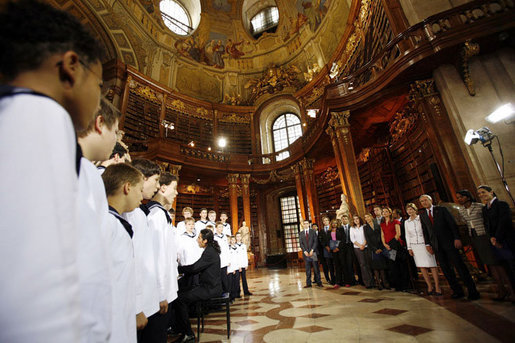 President George W. Bush and Mrs. Laura Bush listen to the Vienna Boys Choir at the National Library at Hofburg Palace in Vienna, June 21, 2006. White House photo by Eric Draper