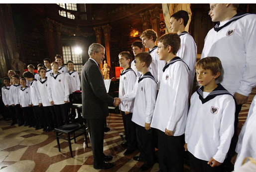 President George W. Bush meets members of the Vienna Boys Choir at the National Library at Hofburg Palace in Vienna, June 21, 2006. White House photo by Eric Draper
