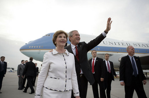 President George W. Bush waves as he and Laura Bush arrive at Budapest-Ferihegy Airport in Budapest Wednesday night, June 21, 2006, on the last leg of their journey to Europe. White House photo by Eric Draper