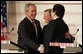 President George W. Bush shakes the hands of Chancellor Wolfgang Schuessel of Austria, center, and European Union President Jose Manuel Barroso following a press availability Wednesday, June 21, 2006, at the Hofburg Palace in Vienna. White House photo by Paul Morse