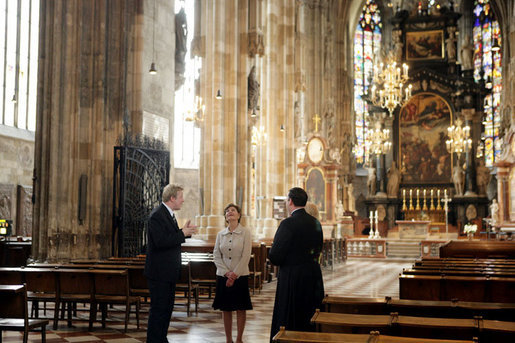 Mrs. Laura Bush admires the architecture of St. Stephen's Cathedral in Vienna, Austria, Wednesday, June 21, 2006, during a tour guided by Bernd Kolodziejczak, left, and Father Timothy McDonnell, right. The cathedral is of one of Vienna's most famous sights built in 1147 AD. White House photo by Shealah Craighead
