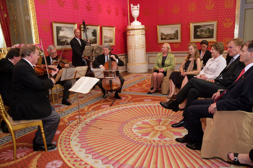 Mrs. Laura Bush listens to a concert by members of the Vienna Philharmonic at the Albertina Museum in Vienna, Austria, Wednesday, June 21, 2006, where she was also given a tour of the museum. White House photo by Shealah Craighead