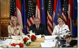 President George W. Bush and Laura Bush are joined by U.S. Ambassador to Austria Susan McCaw during a roundtable discussion Wednesday, June 21, 2006, with foreign students at the National Library in Vienna. White House photo by Eric Draper
